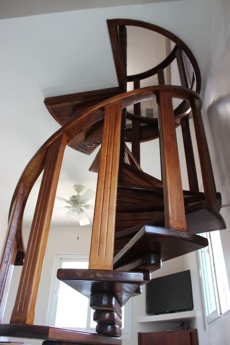 Beautiful wooden staircase to the upper level