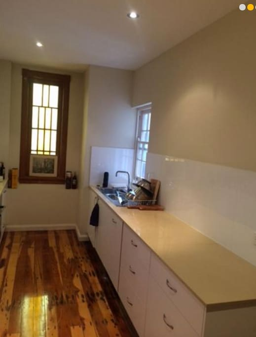 Modern kitchen with gas cook top, oven and dishwasher