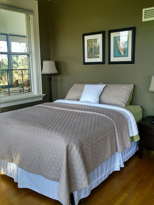 The oversized great room has a queen bed, cable TV, and a sitting area.