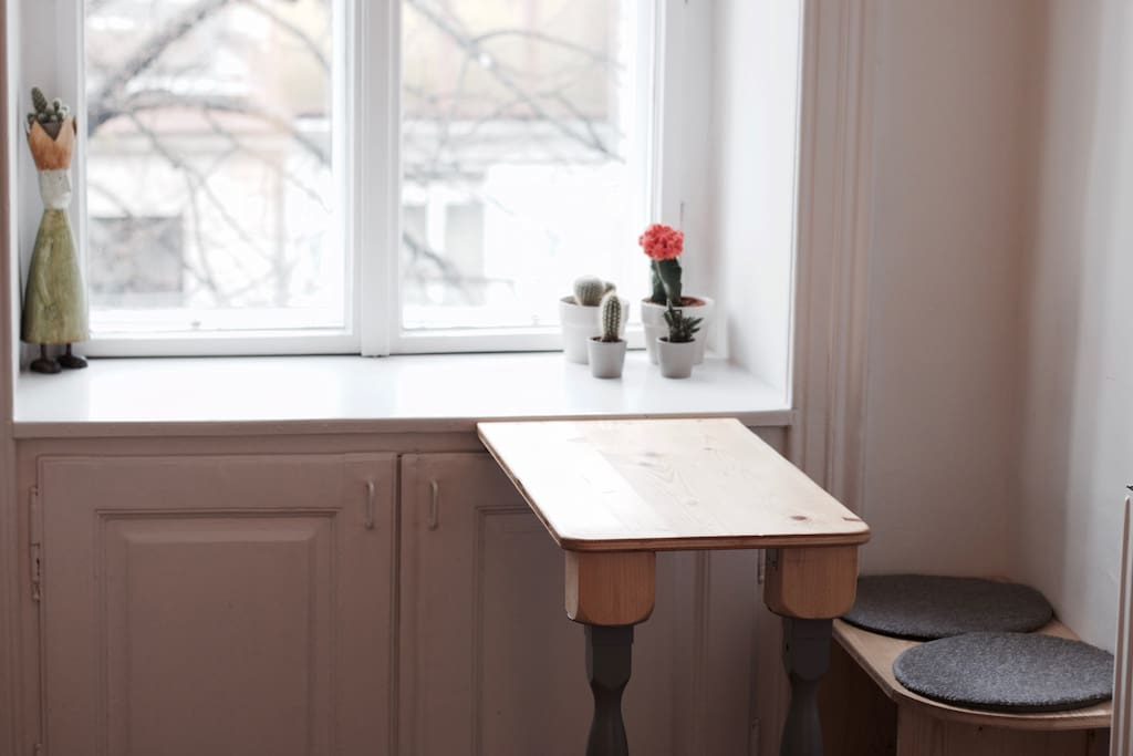 hand-crafted table and chair in the kitchen for breakfast