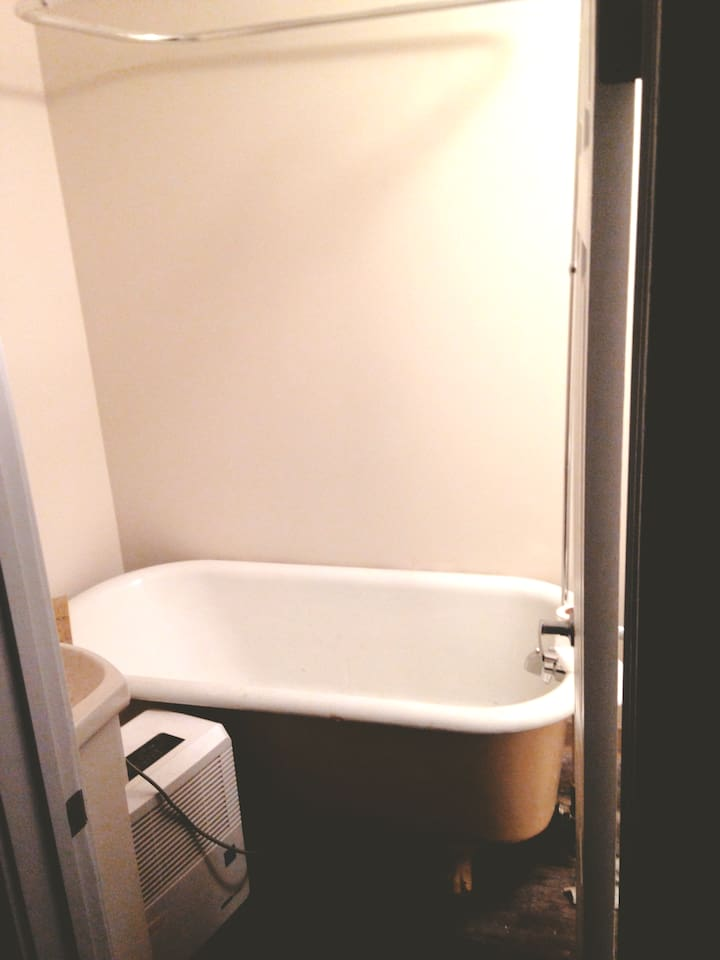 Just down the hall from your room is a cozy little bathroom with a classic clawfoot tub.