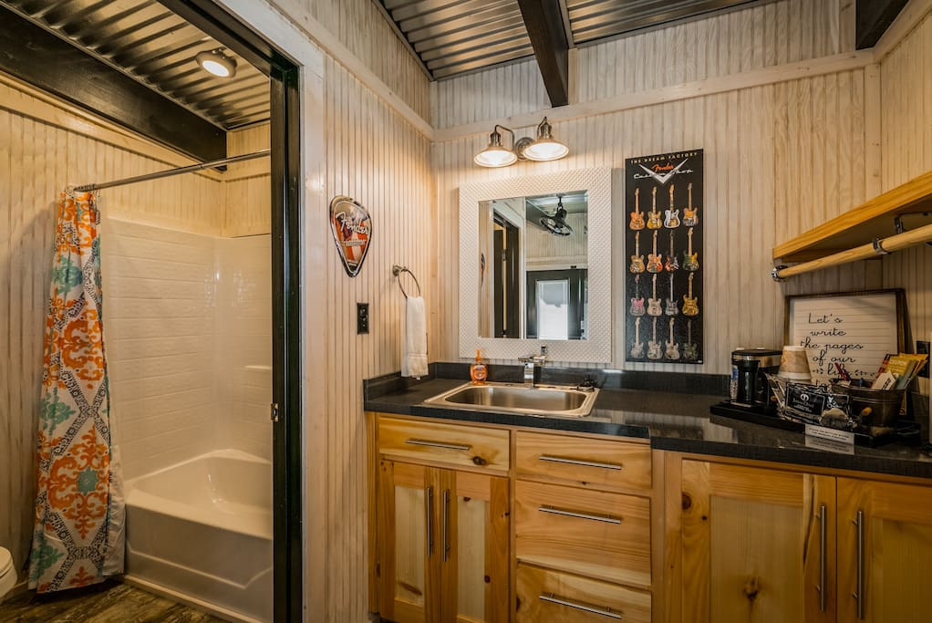 Full bathroom with a separate sink and closet area. This little cottage has everything you need!