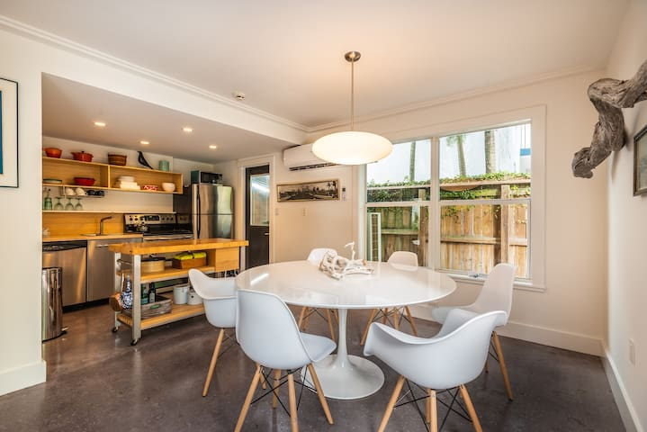 Fully equipped kitchen and dining room looking into the tropical garden