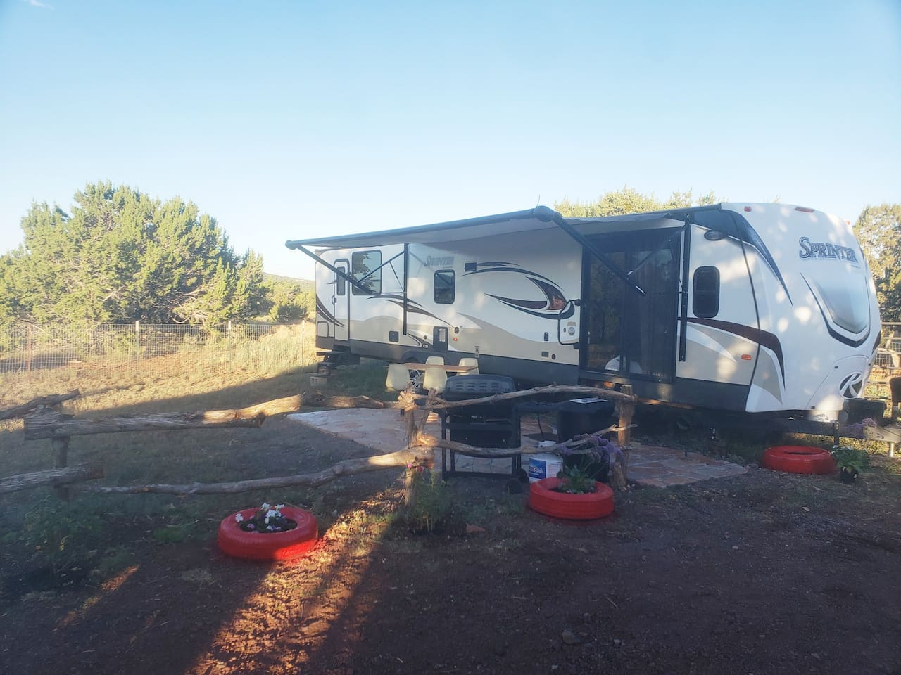 Camping never looked so good! Enjoy a private patio, grill and yard area.