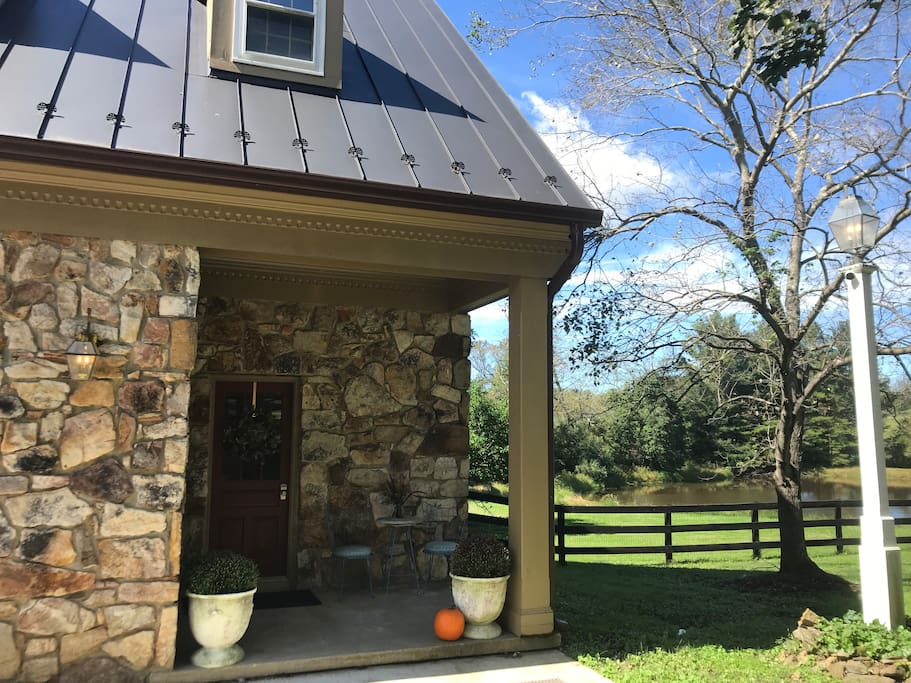 Enjoy coffee on the private porch overlooking ponds and pastures.
