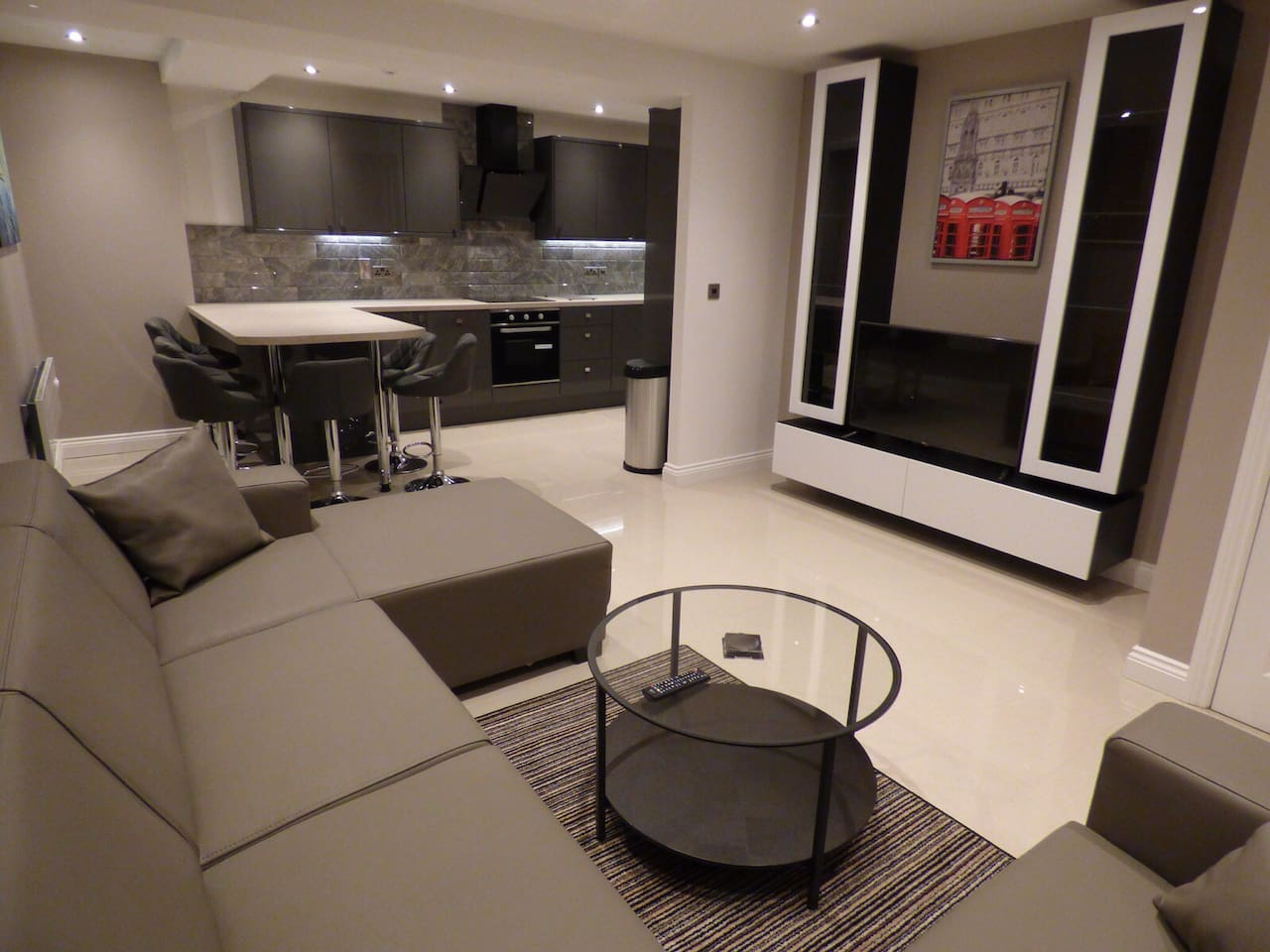 Stunning openplan lounge with large corner sofa, 4K tv, porcelain flooring.