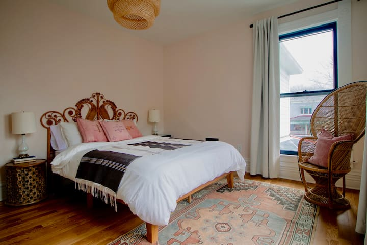 The queen bedroom on the second story is filled with items from around the world as well as a comfy, memory foam mattress and soft linens.