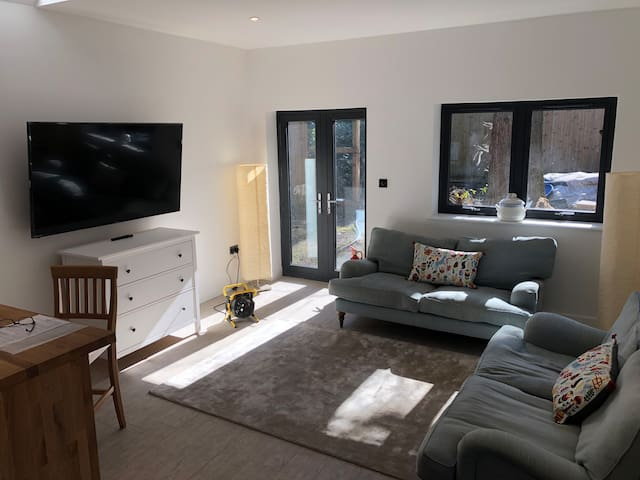 large sitting room with 65 inch LCD TV