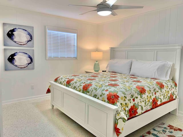 Master bedroom with king bed  Downstairs with door to bathroom.