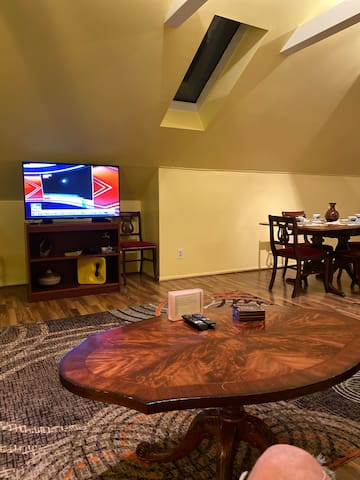 Television from couch with skylight window above
