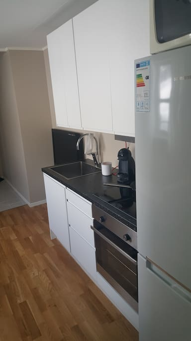 Smart kitchen with Dolce Gusto coffee machine.