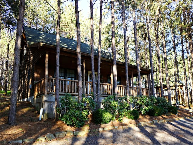Wooded Lake Area Cabin w/Fire Pit & Large Porch Overlooking Pond!
