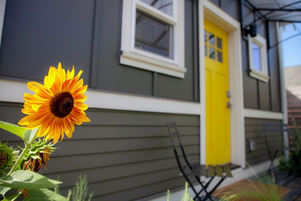 porch entrance & sunflowers in the summer months