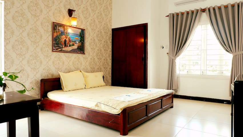 Bedroom 303 with a comfortable double bed for great night's sleep