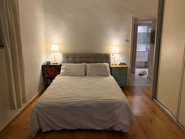 Big bedroom with comfortable double bed , big wall to wall closet, Apple TV and armchair