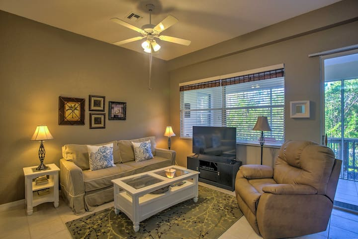 The living room features a plush couch, recliner, and a flat-screen cable TV.