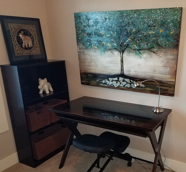 Espresso finish desk with smoky glass and full keyboard tray. The kneeling chair can be switched out with another upholstered chair.