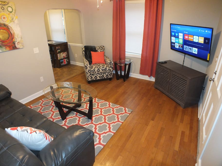 The living room features a new sofa and chair, TV,  DVD, and more!