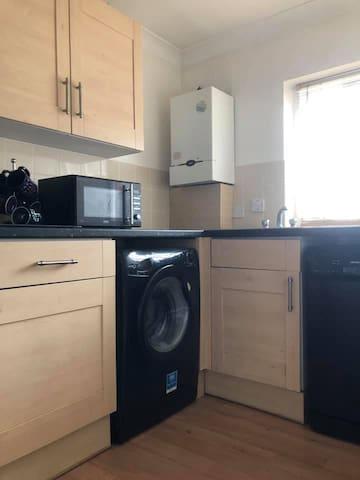 Kitchen. Dishwasher,washing machine, microwave,cooker and nespresso.