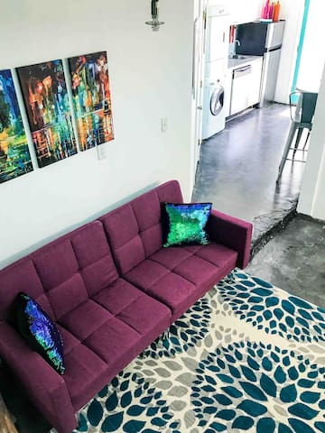 Living room includes futon style couch