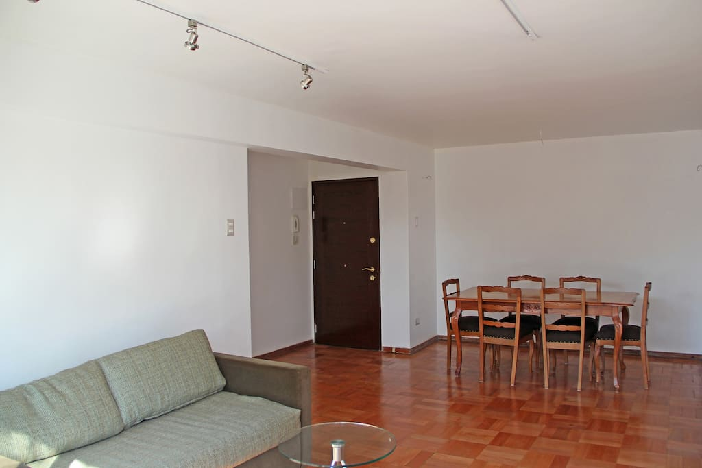 Vitrified parquet wood floor adds a nice touch to the apartment.