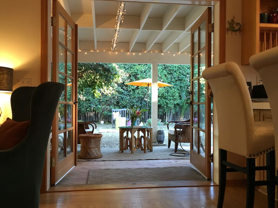 Live inside and out with the covered Veranda. Did  you notice? The doors in this photo have been repainted white.