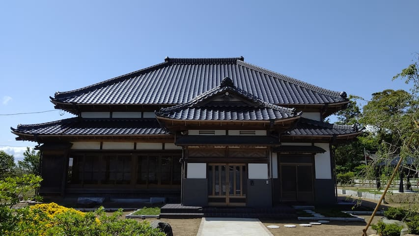Traditional Japanese house with cherry blossoms
