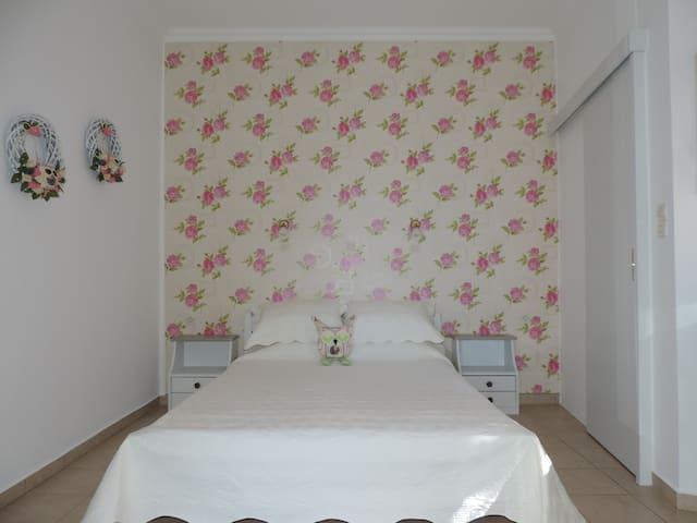 Nostalgia studio ground floor the double bed with nice decoration from Galini!