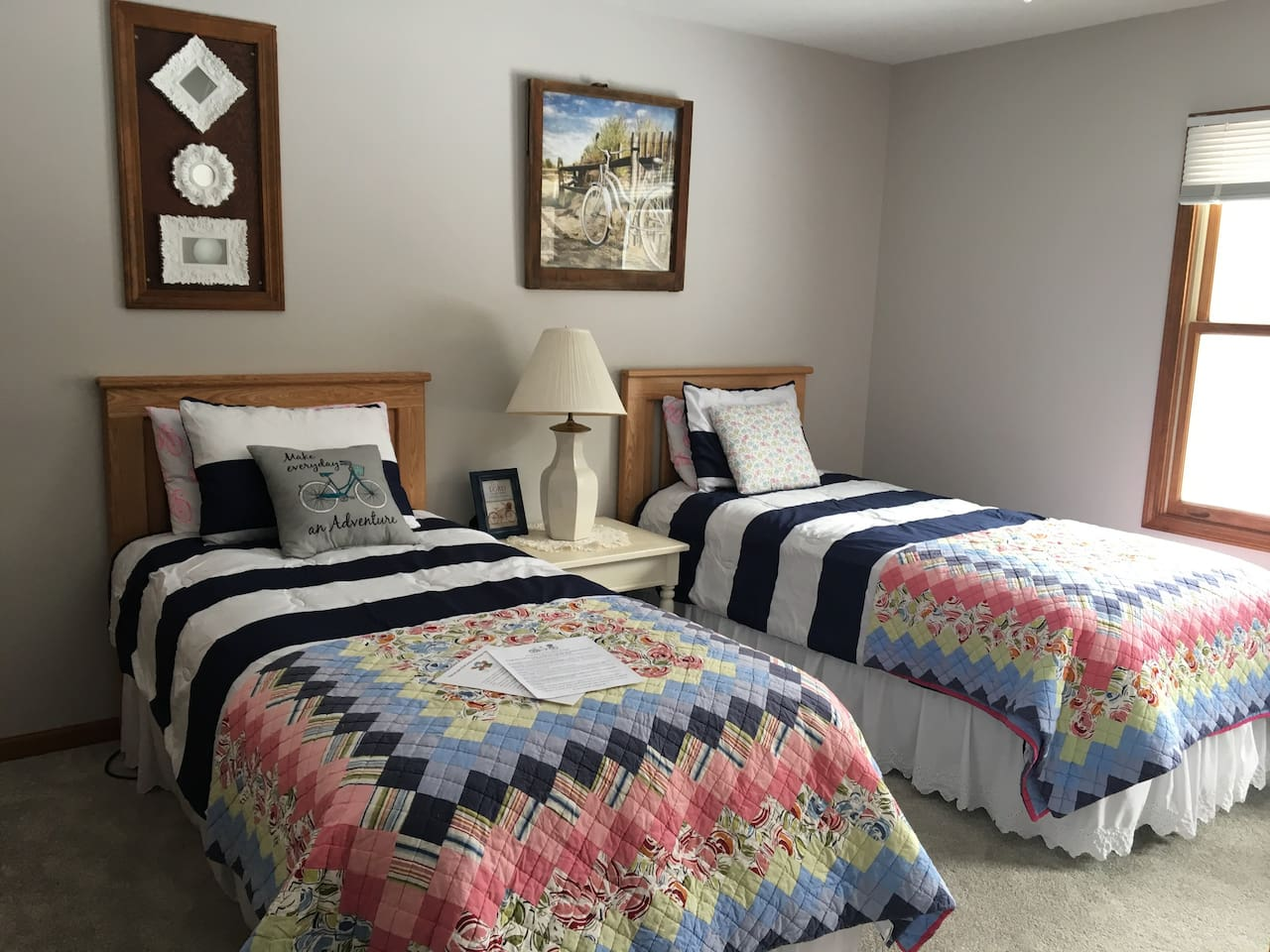 The Bike Room has two xl twin beds.  The bathroom is down the hall with a tub and shower.  It is shared with the Beach room and sometimes rented as a family suite. A full hot breakfast is included.