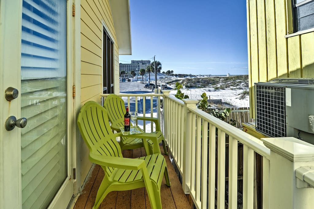 Kick back on the breezy patio, which offers partial ocean views.