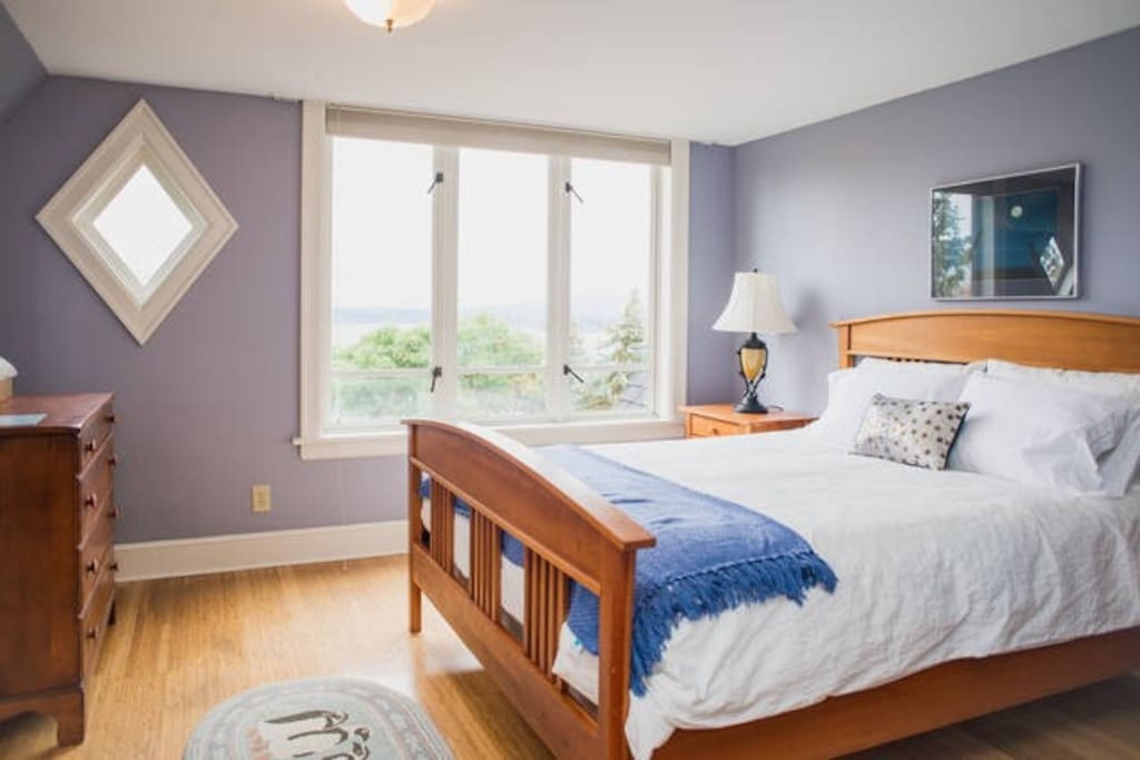 This is the master bedroom with a comfy queen bed.  Wake to the sunrise and watch the eagles soar!