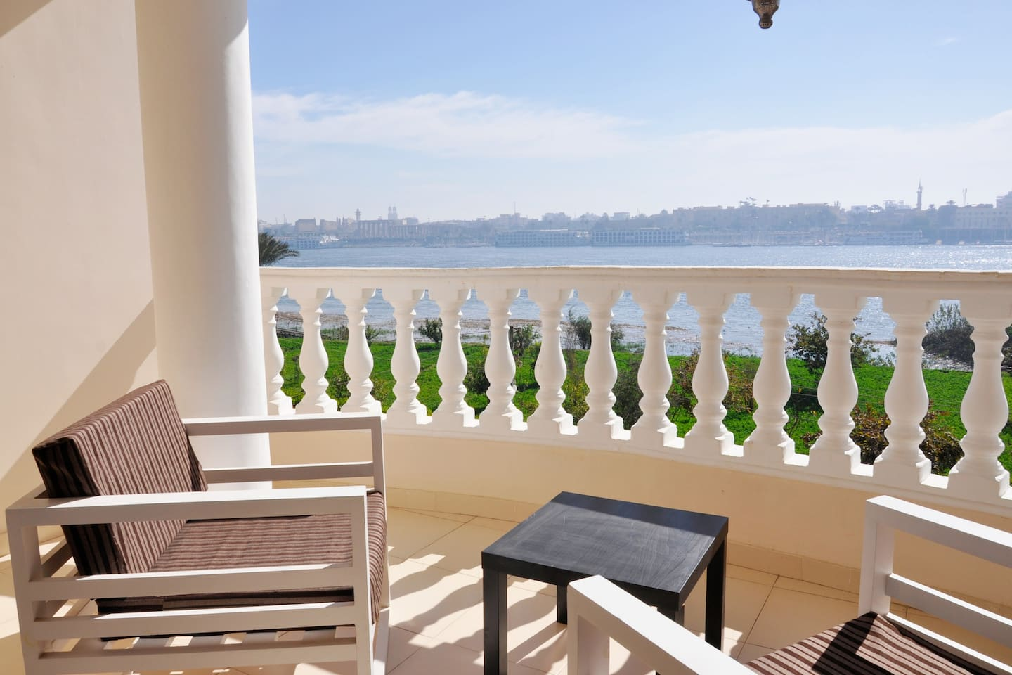 Fantastic view on the Nile & Luxor Temple from the balcony , with comfortable lounge chairs