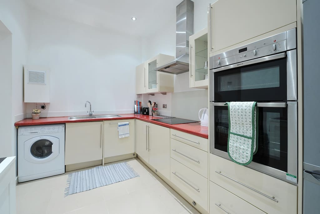 Fully fitted kitchen with essential utensils