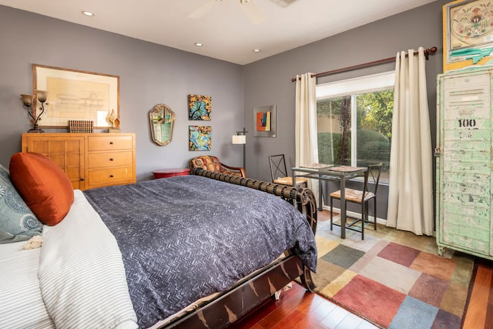 Queen size bed, this one's firm, with a sweet view overlooking the pool!