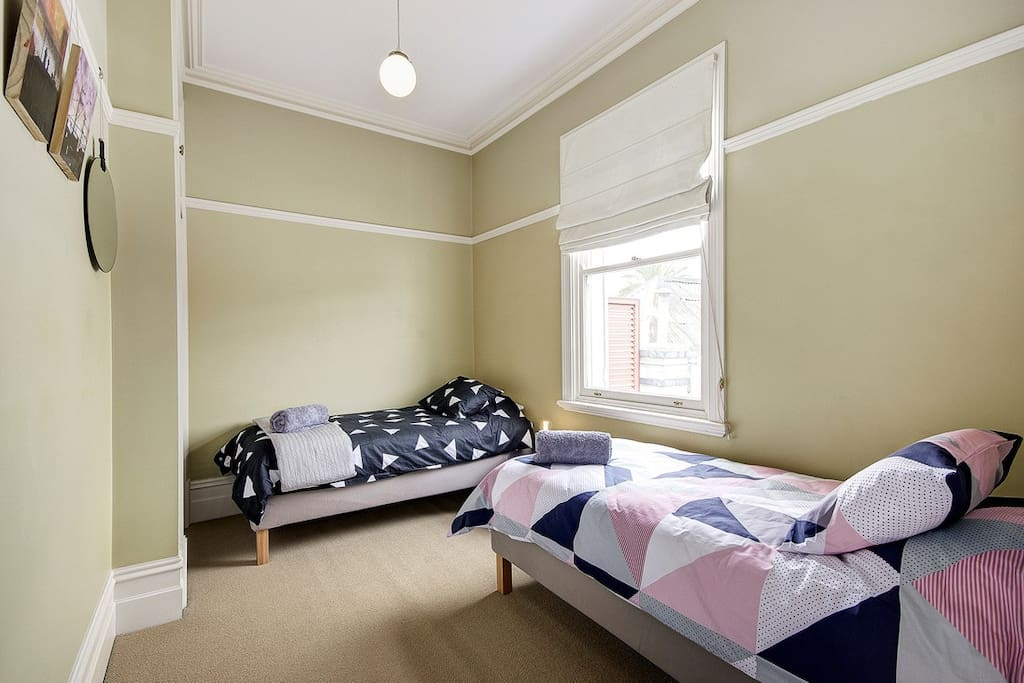 Bedroom two has two single beds the window looks east to the Gardens