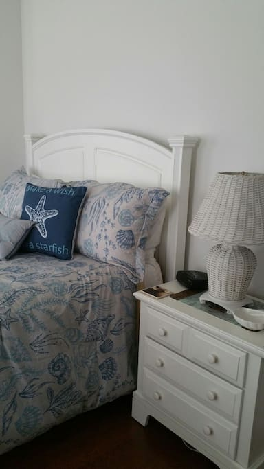 The suite is tastefully decorated with beach theme decor and bed linens.