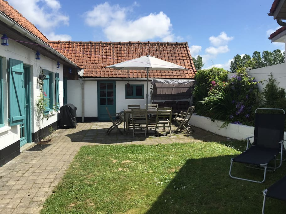 The cow house  garden with swing seat, table and BBQ