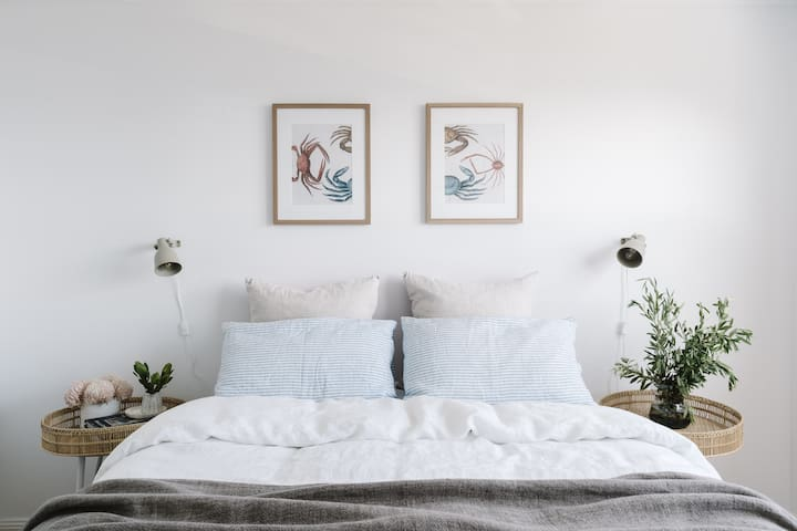 Queen Bedroom | cloud soft cotton and flax linen sheets, doonas and mattress toppers to ensure you get the best nights sleep at The Boathouse.