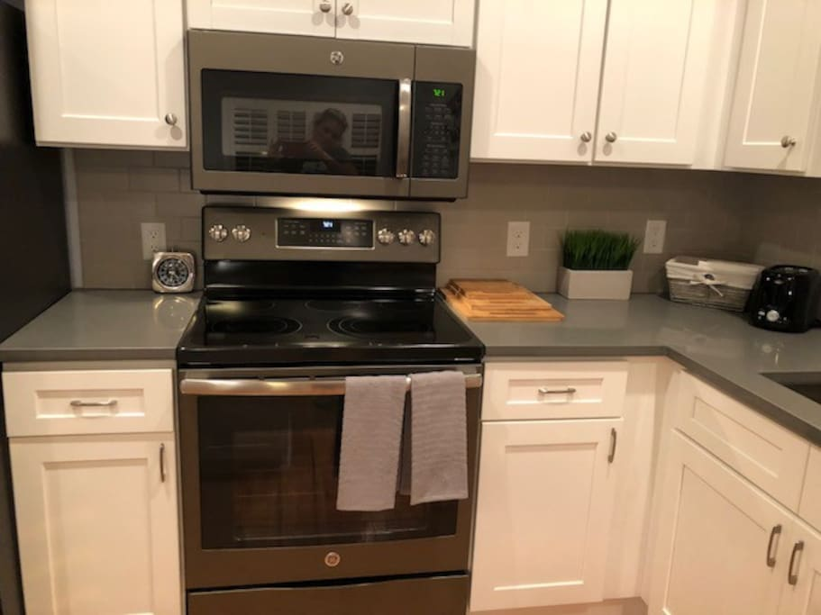 Quartz counter tops and stainless steel appliances.