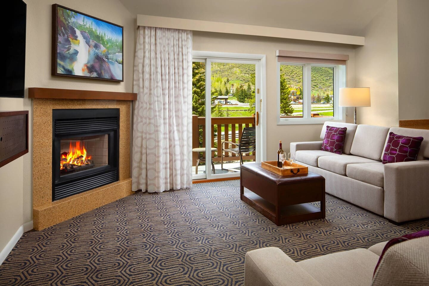 Living area with two queen size sofabeds, flat screen tv, gas fireplace, etc. (Marriott site states room images may not correspond to the actual room received)