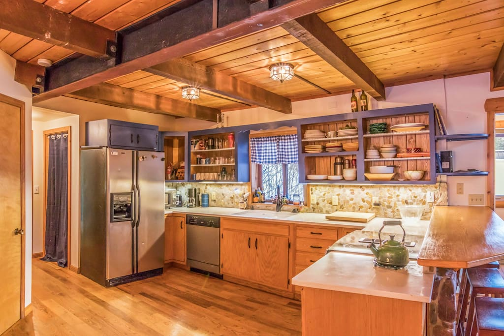 large open kitchen with all the necessities, coffee pot, crock pot, pots and pans etc.