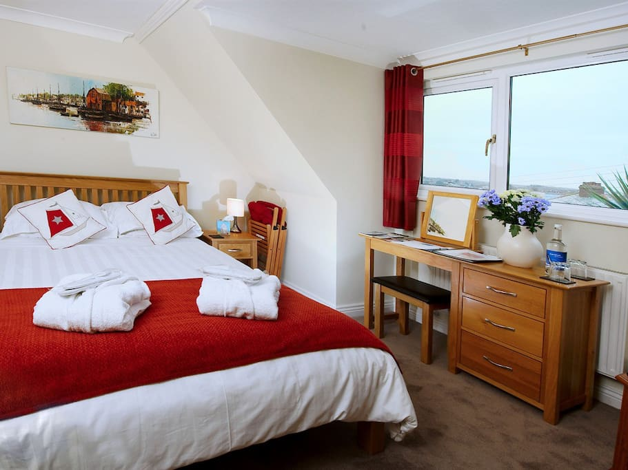 The Padstow room - well appointed for single travelers with king size double bed and en suite shower room.