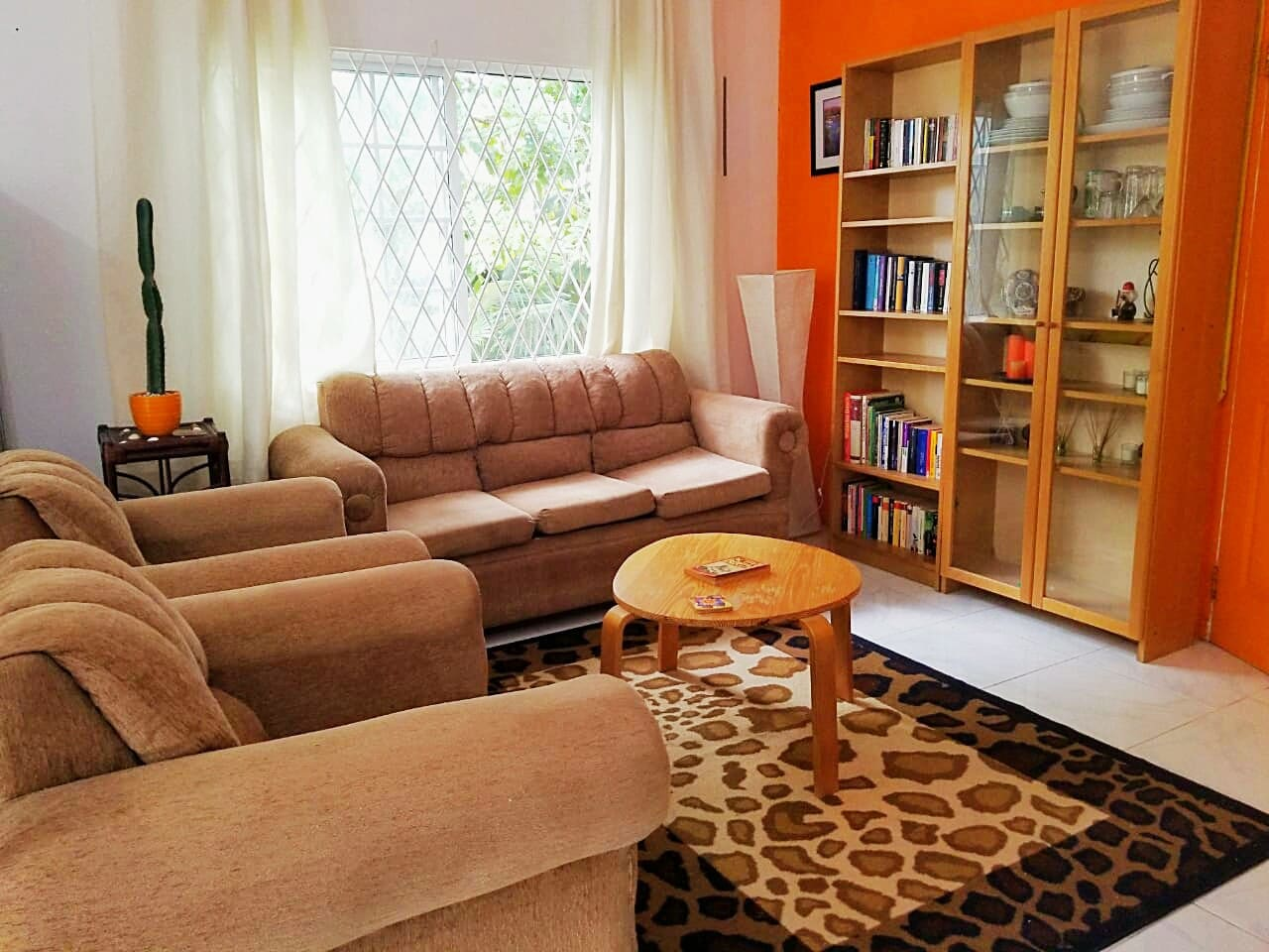 Cozy living room with our German & English book collection