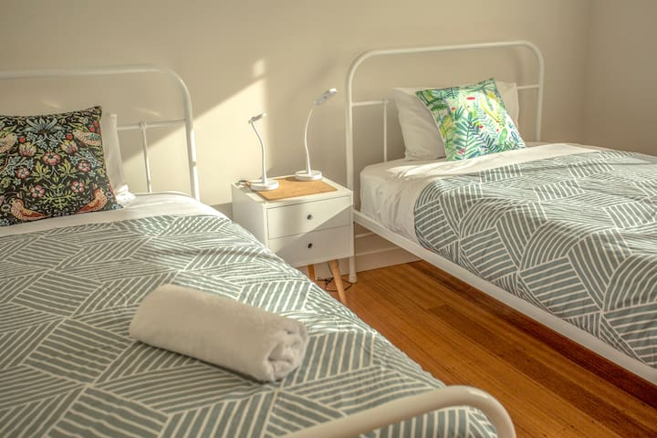 The second bedroom has two single beds, each with a heated mattress to keep you cozy at night.