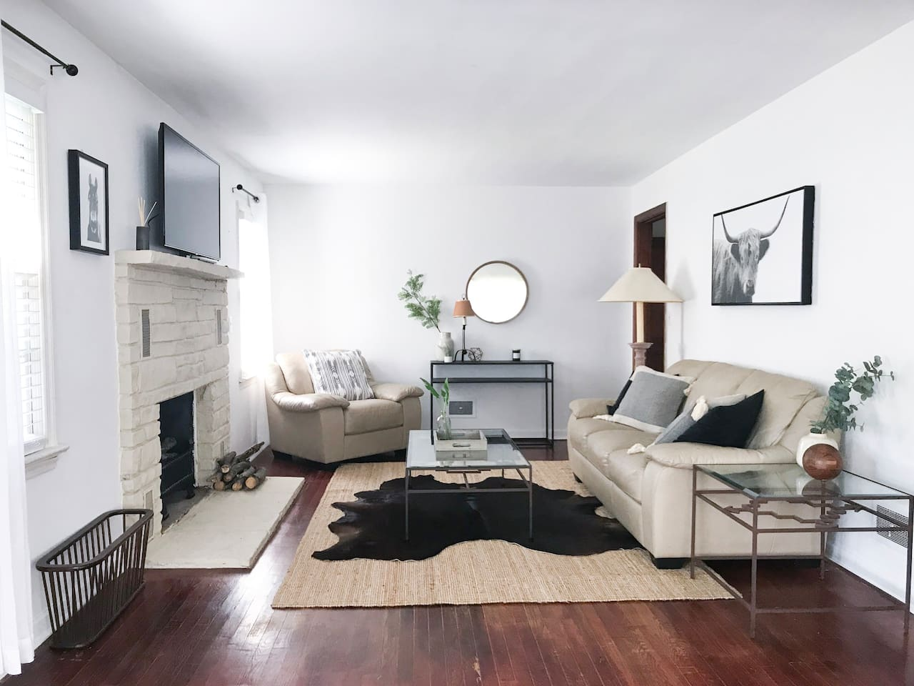 The living room offers cozy comfortable seating and modern farmhouse decor, along with cable TV. Please note that the fireplace is unfortunately non-functional at this time.
