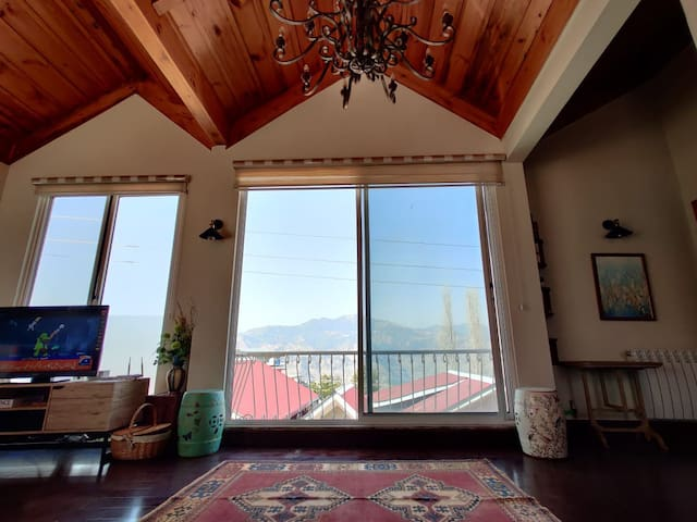 The huge floor to ceiling windows in the living room overlooking the khaira Gali, Nathia Gali hills