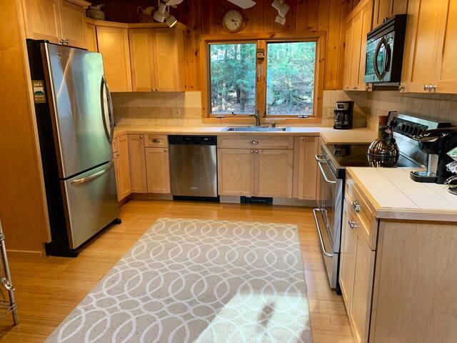 Updated, fully equipped kitchen with stainless appliances