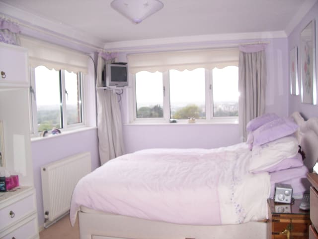 Guest bedroom with dual aspect views 1 over Swansea Bay and other to our local mountain