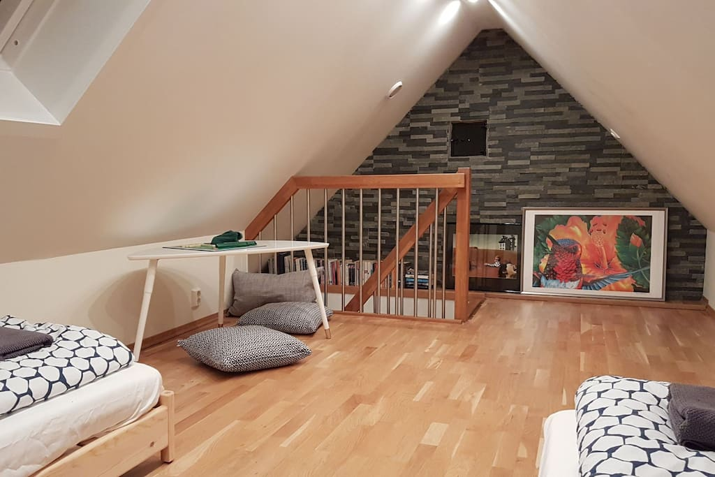 The loft space is open (no door) via the stairs to the shared living room below