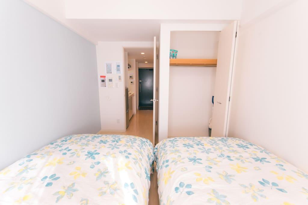 A bedroom with a closet